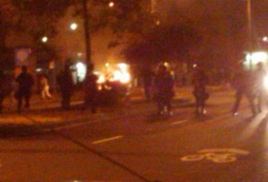 Protesters ignite several trash fires throughout downtown Oakland, as police in riot gear move in near Broadway and Grand Avenue. By Oakland Voices correspondent Dawneka Akins.