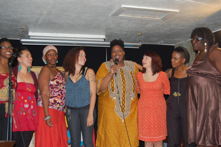 At a recent event, Shepeople's founder Valerie Troutt (fourth from the right) thanks several artists, inculding her mother Valerie Brown-Troutt (far right), and visual artist Corinna Nicole Brewer (fourth from the left).