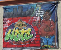 A small banner is the only indication of plans to turn a boarded up former church into the West Oakland Teen Center. By Tyrese Johnson