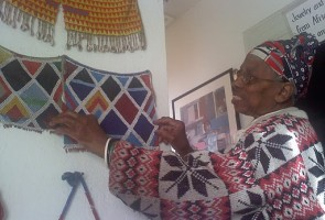 "Aissatoui A. Vernita at her Ebony Museum of Art in West Oakland. Now in her early 80s, Vernita has been collecting African and black American art ""since the age of 9."" By Cameron Wilson"