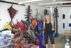 Sequoia Elementary School Artist-in-Residence Debbie Koppman poses with just a few of her many artworks in her home studio in East Oakland