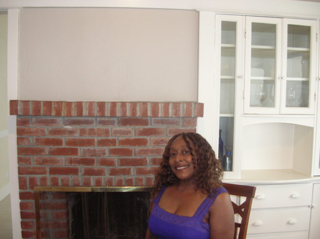 Michelle McAfee has been a teacher at Park Day School for more than 20 years.  Here she is in her recently purchased East Oakland home in July 2012.