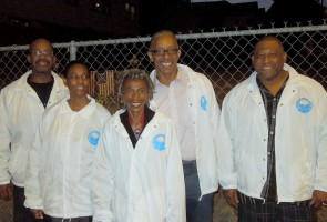 Pastor Rev. Dr. Phillip A. Lewis (center) and a few of the volunteers from City Team.
