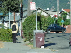 Teenager walks past the scene of the 100th homicide on 57th and Hilton. 10/15/2012