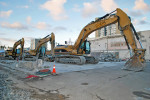 Three excavators lined up and ready for a hard day's work.  (Three Excavators.  Edward Cervantes, Oakland Voices 2012.)