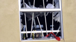 """Red """"Danger"""" tape on the site's shattered windows cautions would be trespassers.  (Red Ribbon of Danger.  Edward Cervantes, Oakland Voices 2012.)"""