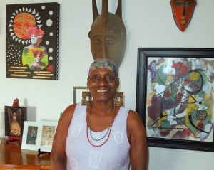 Nedra, with some of her art.  Photo by Howard Dyckoff, Oakland Voices, 2012.