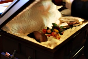 Winston Callender, 29, lies in his casket as it's being closed