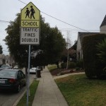 More signage located near the elementary school. There are several signs like this on each side of the street  to help curb speeding along busy 55th Avenue, as children make their way to school. Katherine Brown - Oakland Voices.