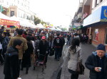 The street festival on February 3 in Oakland Chinatown is crowded. Photo: Jian Di Liang. Oakland Voices, 2012.