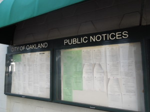 Public notices board in Frank H. Ogawa Plaza at City Hall