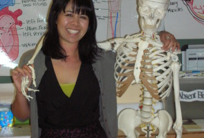 Alison Ball and her friendly classroom skeleton Photo: Oakland Voices/January 2013