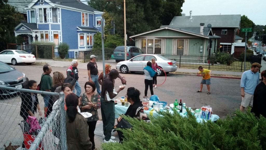 Gathering around the food table on 11th Avenue