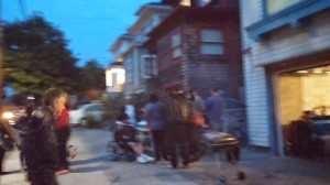 A barbeque on 9th Ave, hosted in a garage draws a talkative crowd