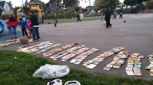 Books laid out for the taking  at Bella Vista park, from the elementary school