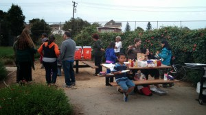 People gather at the potluck tables, offering conversation and a breather.