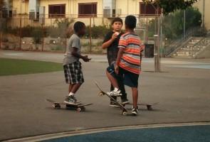 Skater kids enjoy Bella Vista park early in the evening.