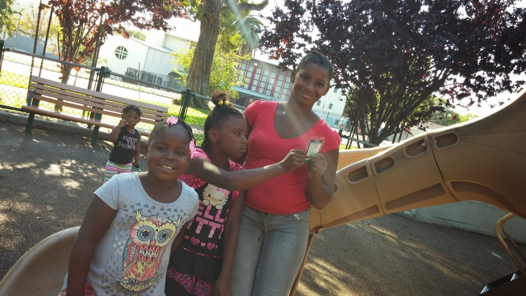 Trinity and Jaden watch their younger siblings at the San Antonio playground