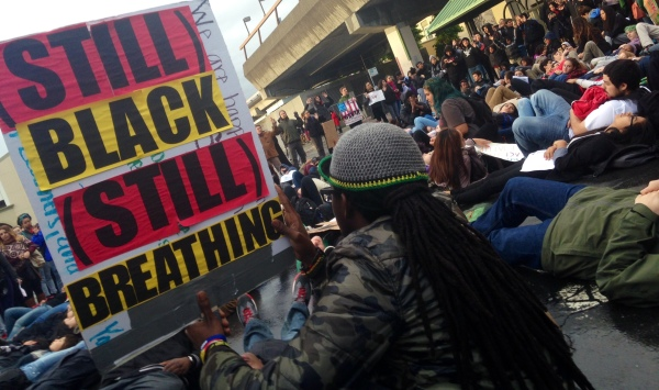 """Oakland student staged a """"die-in"""" outside the Fruitvale Station Monday evening in support of the growing movement Black Lives Matter."""