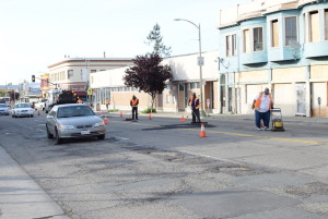 Workers patch holes in the street