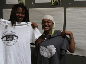 Tiphekreth TK, on the right, shows off one of her designs