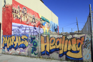 Cultural and political murals cover the walls of the Eastside Arts Alliance on International Boulevard on Wednesday, March 16, 2016 in Oakland, Calif. Students and professional artists team up to create the murals.(Laura A. Oda/Bay Area News Group)