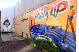 Cultural and political murals cover the walls surrounding the Eastside Arts Alliance on International Boulevard on Wednesday, March 16, 2016 in Oakland, Calif. Students and professional artists team up to create the murals.(Laura A. Oda/Bay Area News Group)
